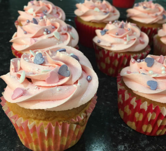 Pink cupcake with sprinkles by LucyyBakes