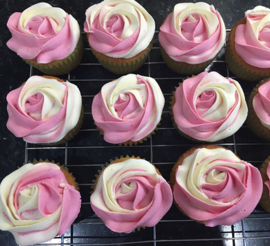 Tray of rose cupcakes by LucyyBakes