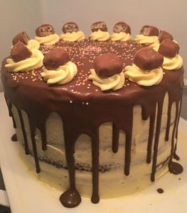 Cake with chocolates on top by LucyyBakes